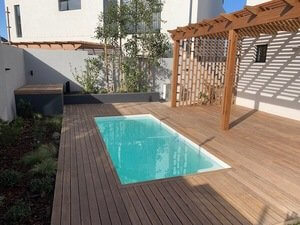 Custom white pool with decking